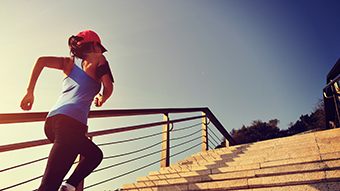 image of woman running up stairs
